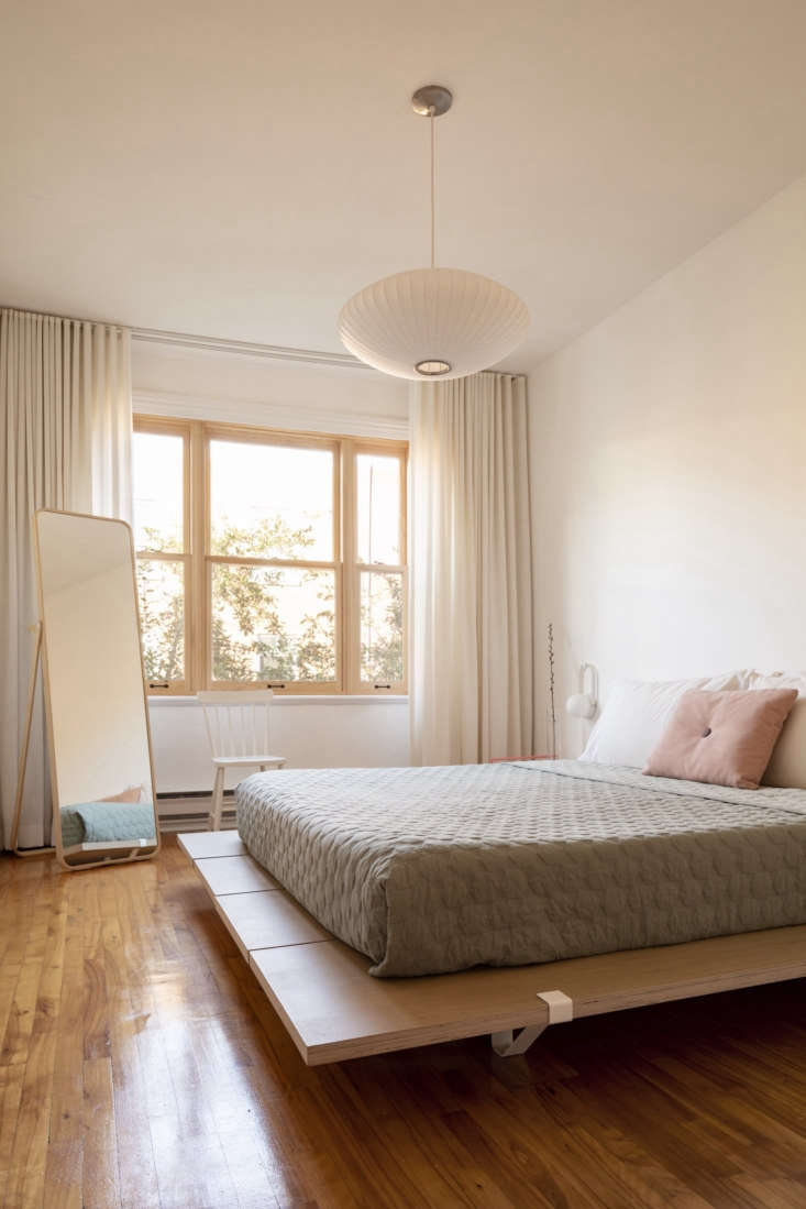 the third floor has two bedrooms. here, simplicity abounds. a nelson bubble lam 22