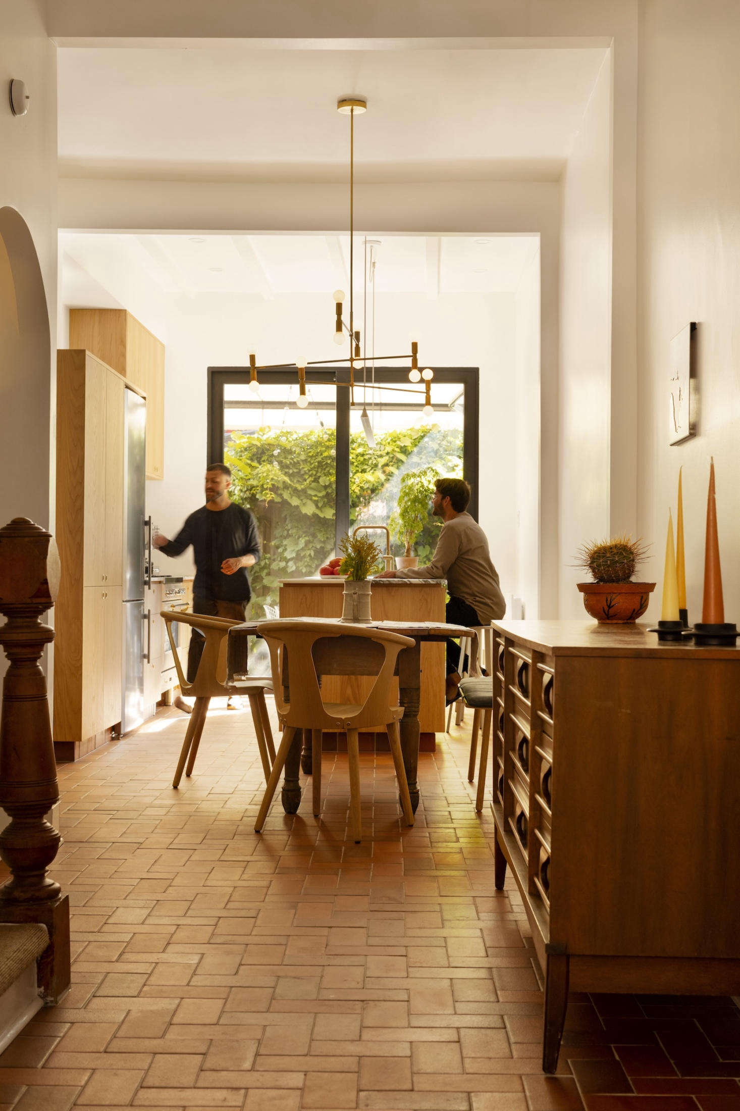 The kitchen, dining, and living rooms comprise the second floor. The terracotta tiled floors are new but replicate the original flooring in the kitchen.