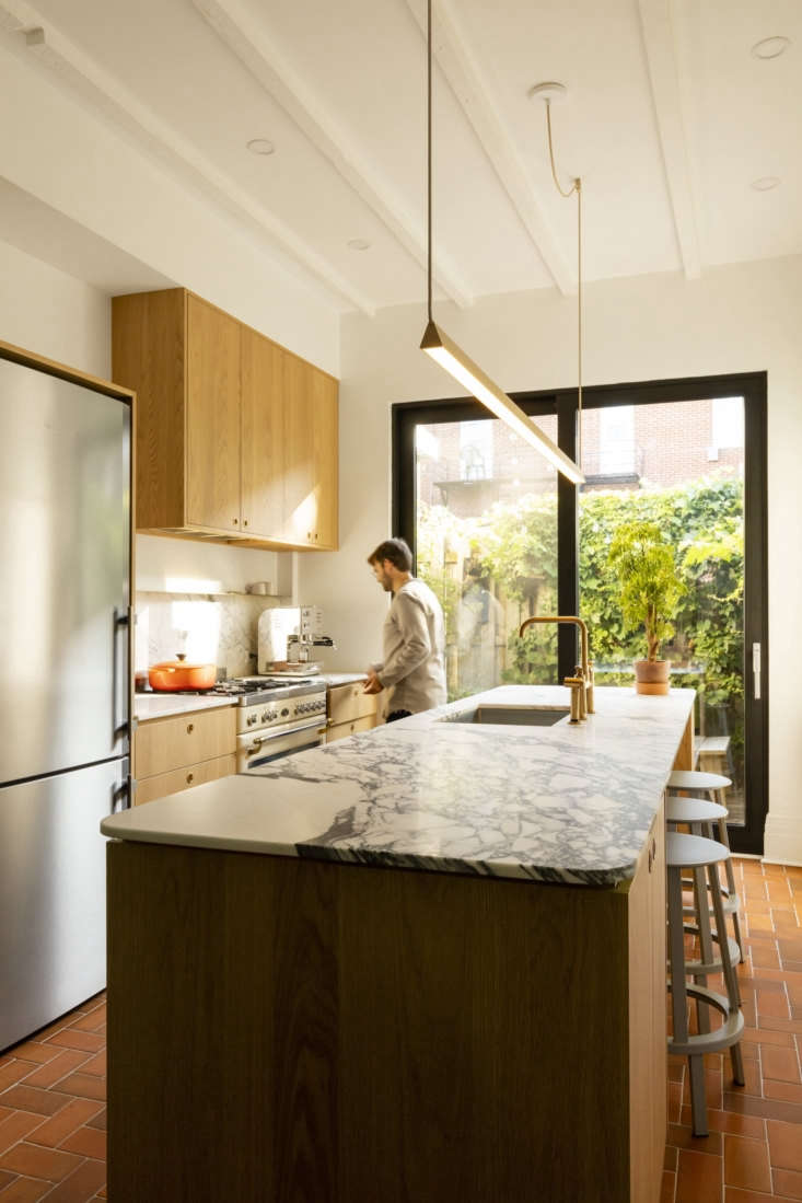 just off the kitchen is the couple&#8\2\17;s lush courtyard. calacatta arab 17