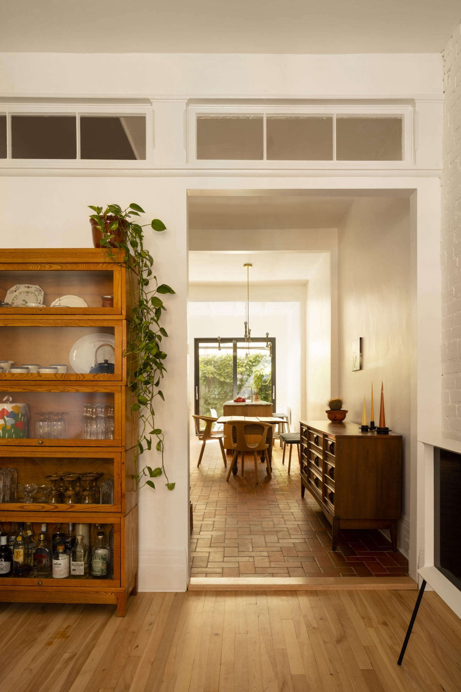 The long view, from the living room, toward the dining room, into the kitchen.