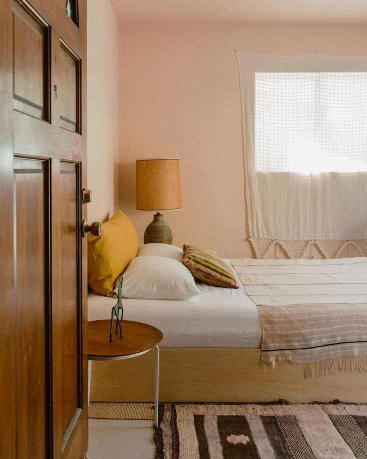 Merchant House High Desert A SpanishStyle Oasis in the Mojave Each bedroom has a simple platform bed and subtly pink walls.