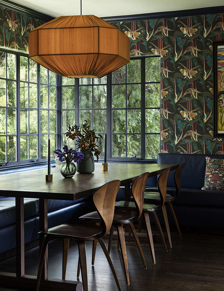 A black Naugahyde banquette wraps around a corner of the dining area. Klaus Haapaniemi&#8