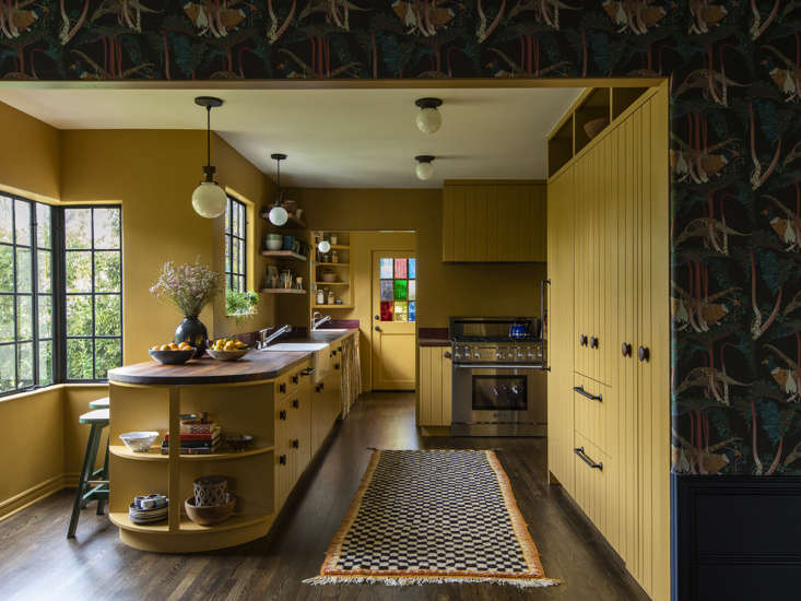 First things first: Frances got rid of the white laminate cabinets and had more period-appropriate tongue-and-groove cabinets built in their stead. A coat of Benjamin Moore&#8