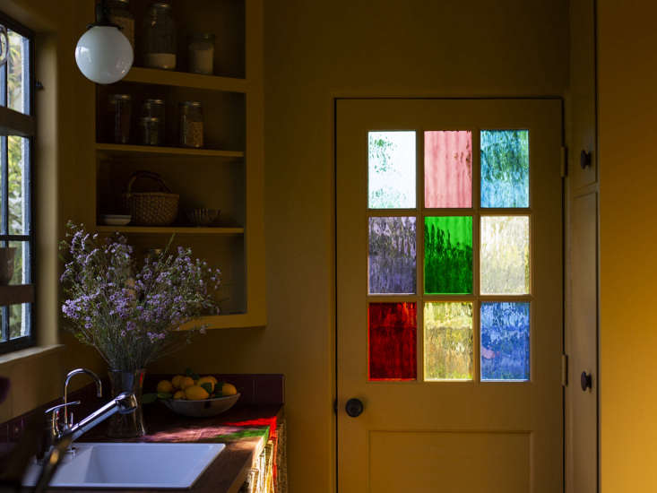 An unexpectedly pretty side door, thanks to colored glass panels (from Sunshine Glass) that replaced the standard clear ones.