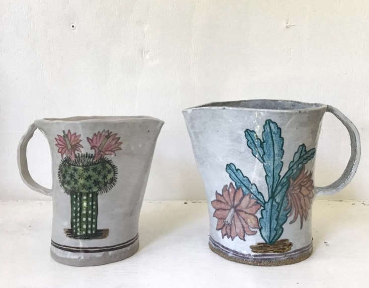 Pitchers bearing paintings of blooming cacti.