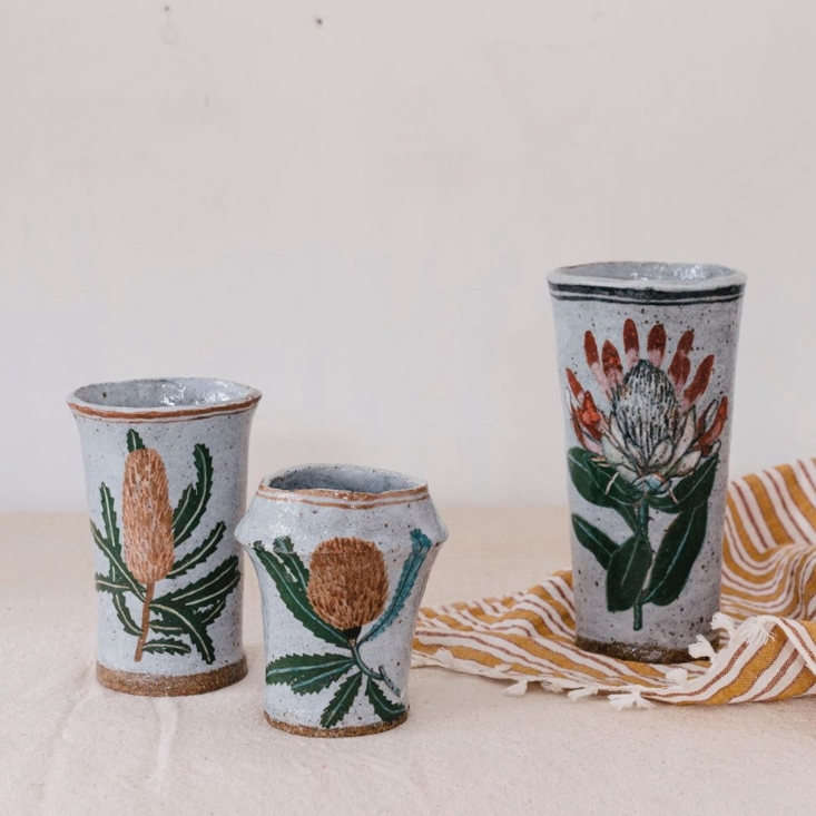 Her ceramic paintings are often inspired by illustrations from vintage everyday items like a Mexican bingo set from the 00s, a seed savers exchange catalogue, or a California native plant identification book. A similar large Protea Vase is $435 at Nickey Kehoe. Photograph by @arna__.