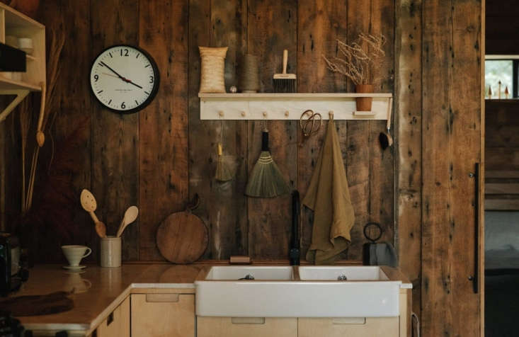 Retreat for Two A Lakeside Rental Cabin at Settle in Norfolk England The wall hung shelves are by Remodelista favorite Woodchuck: see Tinta and Rutger Luhrman&#8\2\17;s own kitchen here. Woodchuck&#8\2\17;s Yori Shelf holds utensils over the sink. The matte black faucet is by Meir. Jo stocks the quarters at Settle with wares by small makers, many of them local. A selection are for sale in the Settle boutique.