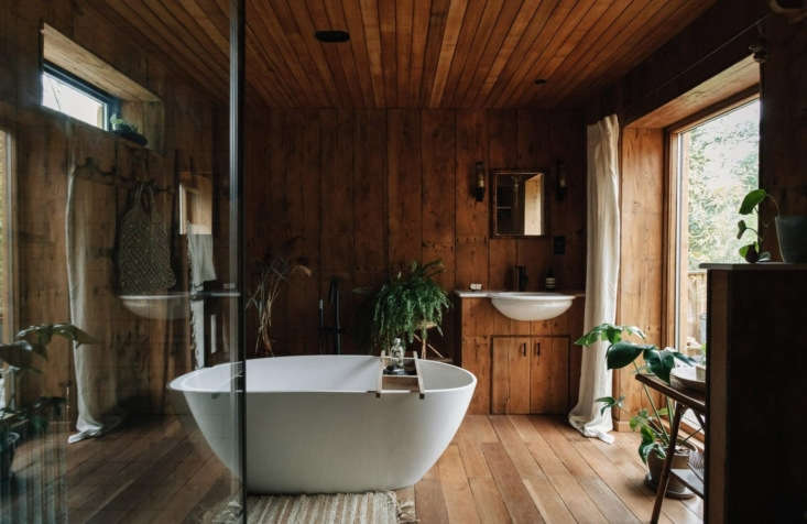 Retreat for Two A Lakeside Rental Cabin at Settle in Norfolk England Jo succeeded in her campaign for a large spa bath with a lake view. In addition to the egg shaped bath, there&#8\2\17;s a tiled shower.