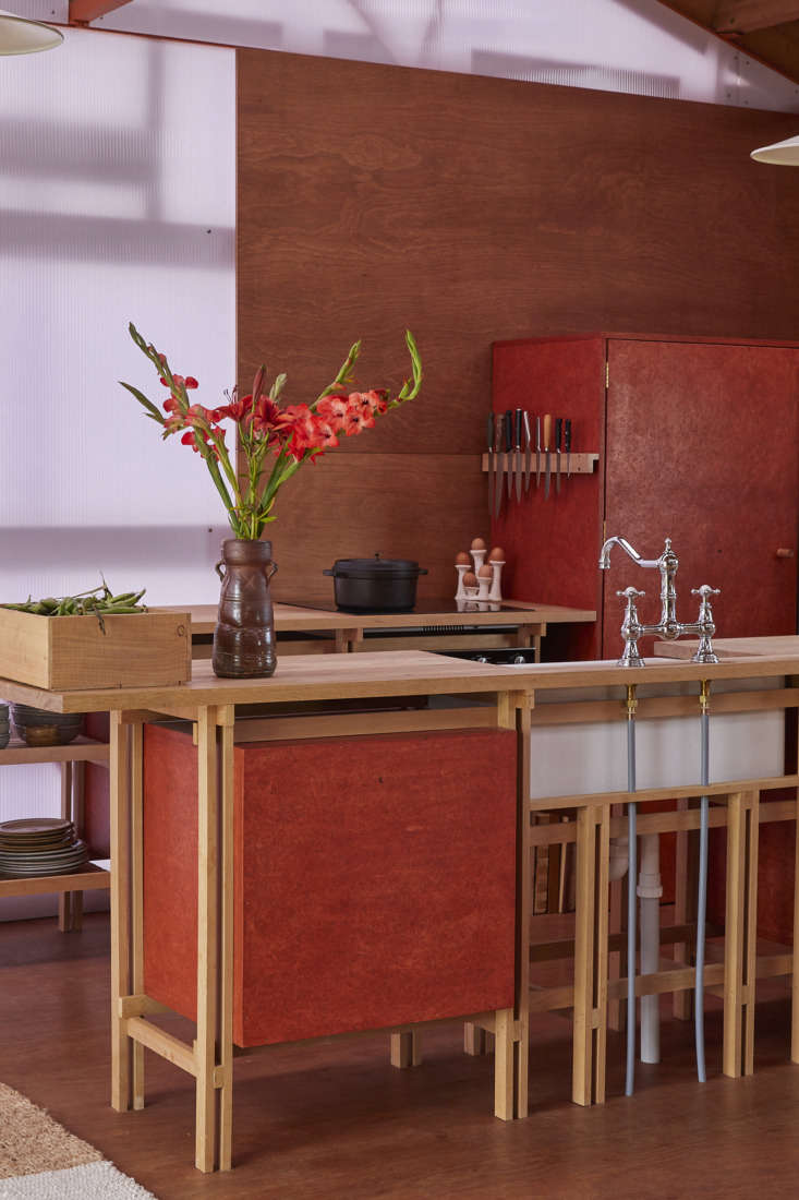 Inspired by Japanese joinery, the kitchen is designed as a series of &#8