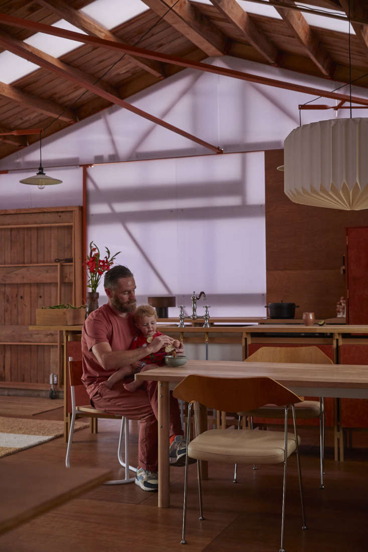 ben and hattie sit on a leather backed chair at a table of solid american oak,  14