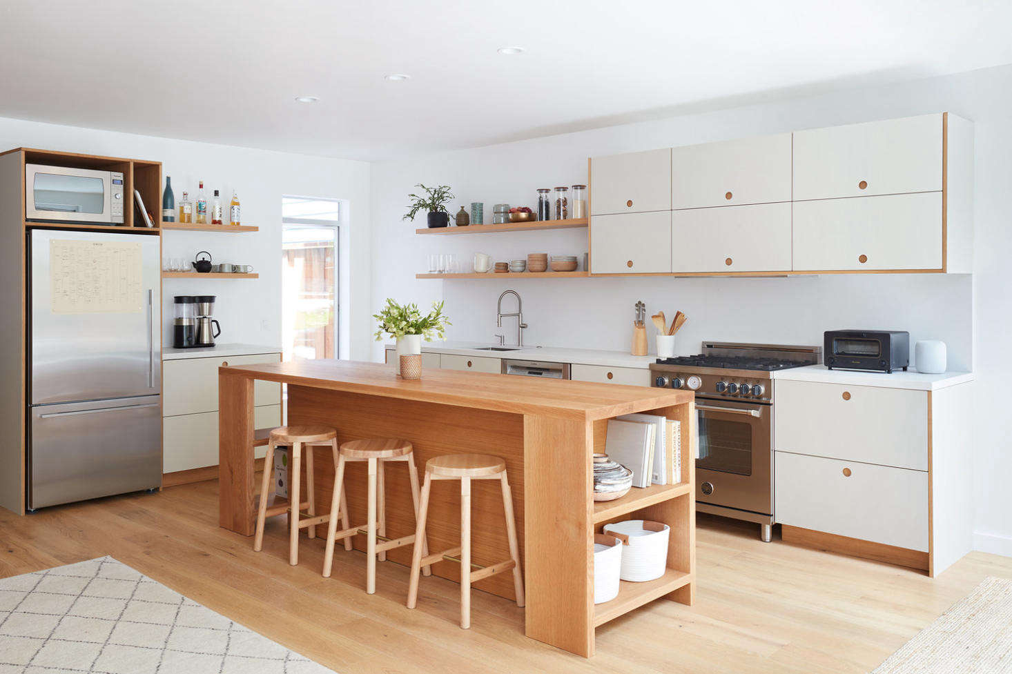 The white oak kitchen island is designed by Amy and constructed by a local woodworker. &#8