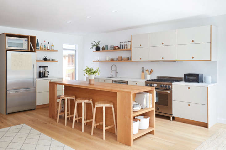 the white oak kitchen island is designed by amy and constructed by a local wood 11