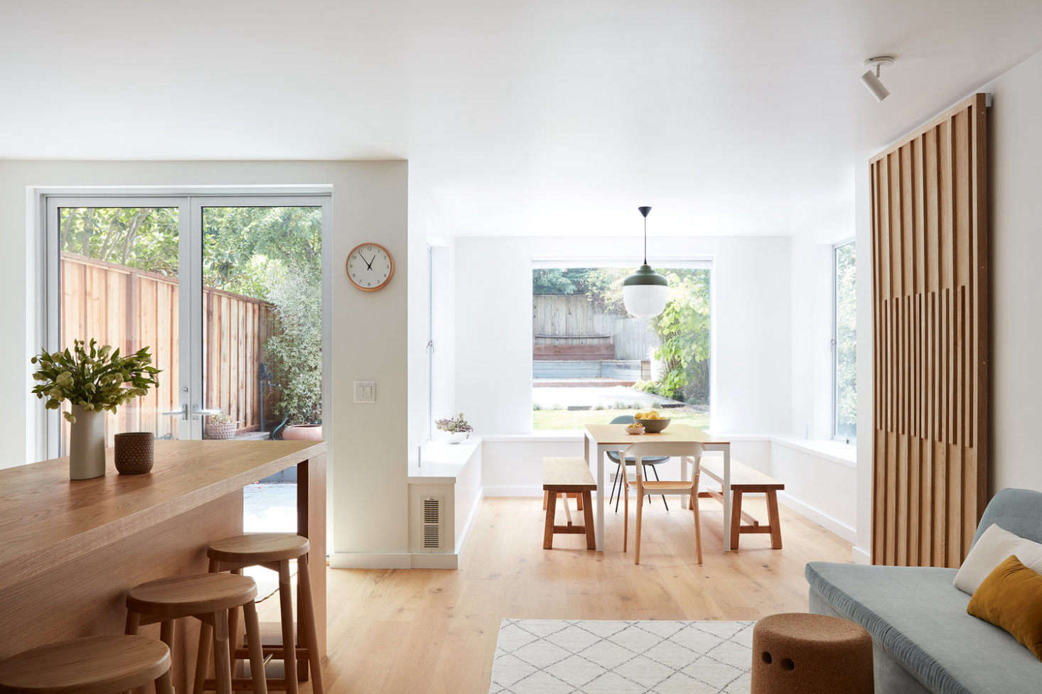 The kitchen is open to the living and dining areas. The walls are painted Benjamin Moore&#8