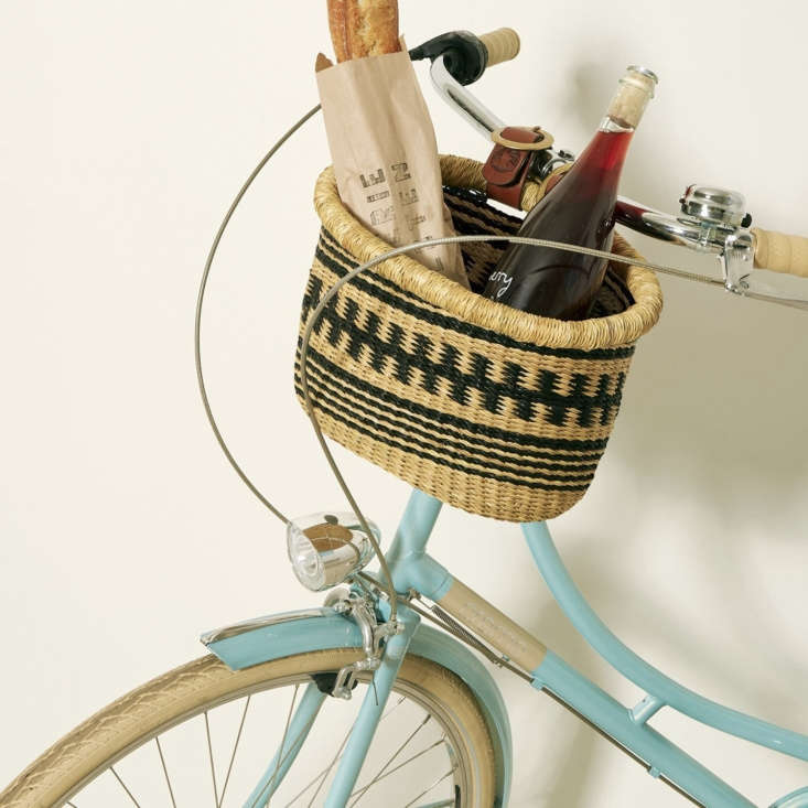 the handwoven, fair trade medium bicycle basket (\$80), also by baba tree, stra 14
