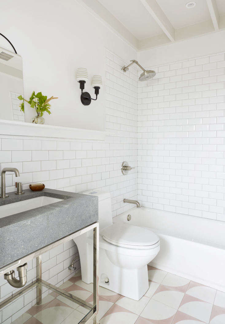 The bath has beveled subway tiles on the wall and Cle&#8