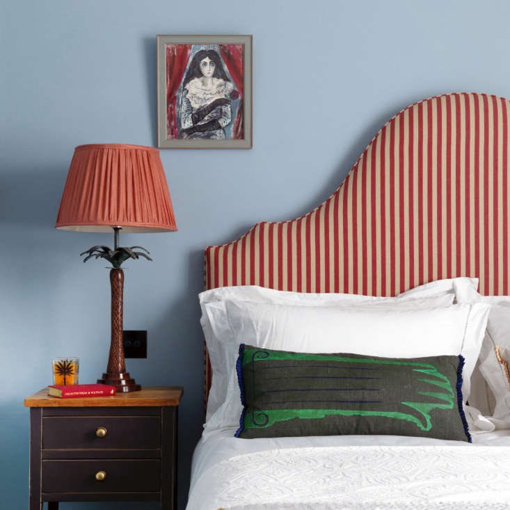 The headboard is upholstered in a stripe from Claremont. &#8