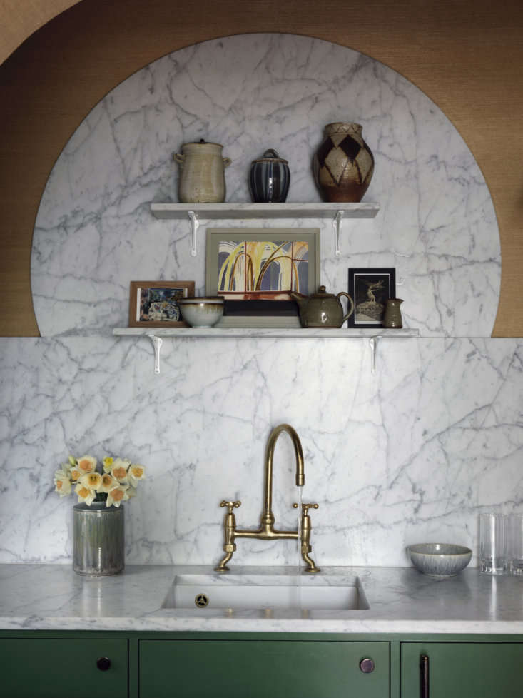 As a flourish, Heuman designed the marble backsplash to rise in a half moon: &#8
