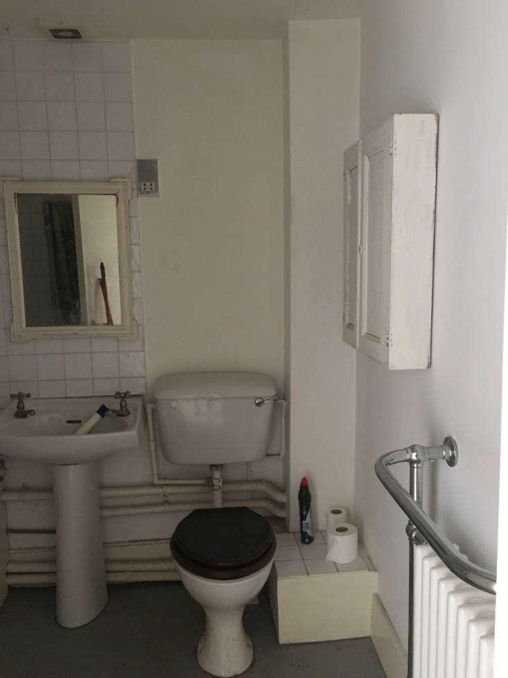 The bathroom had received a slapdash remodel quite a few years ago.