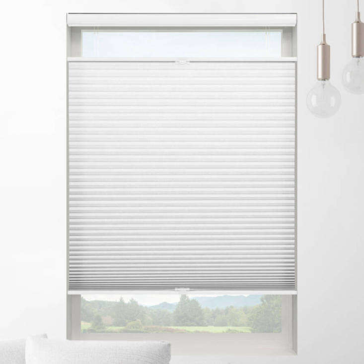 The Classic Top Down Bottom Up Light Filtering Shades are a budget choice starting at $37. from Select Blinds.