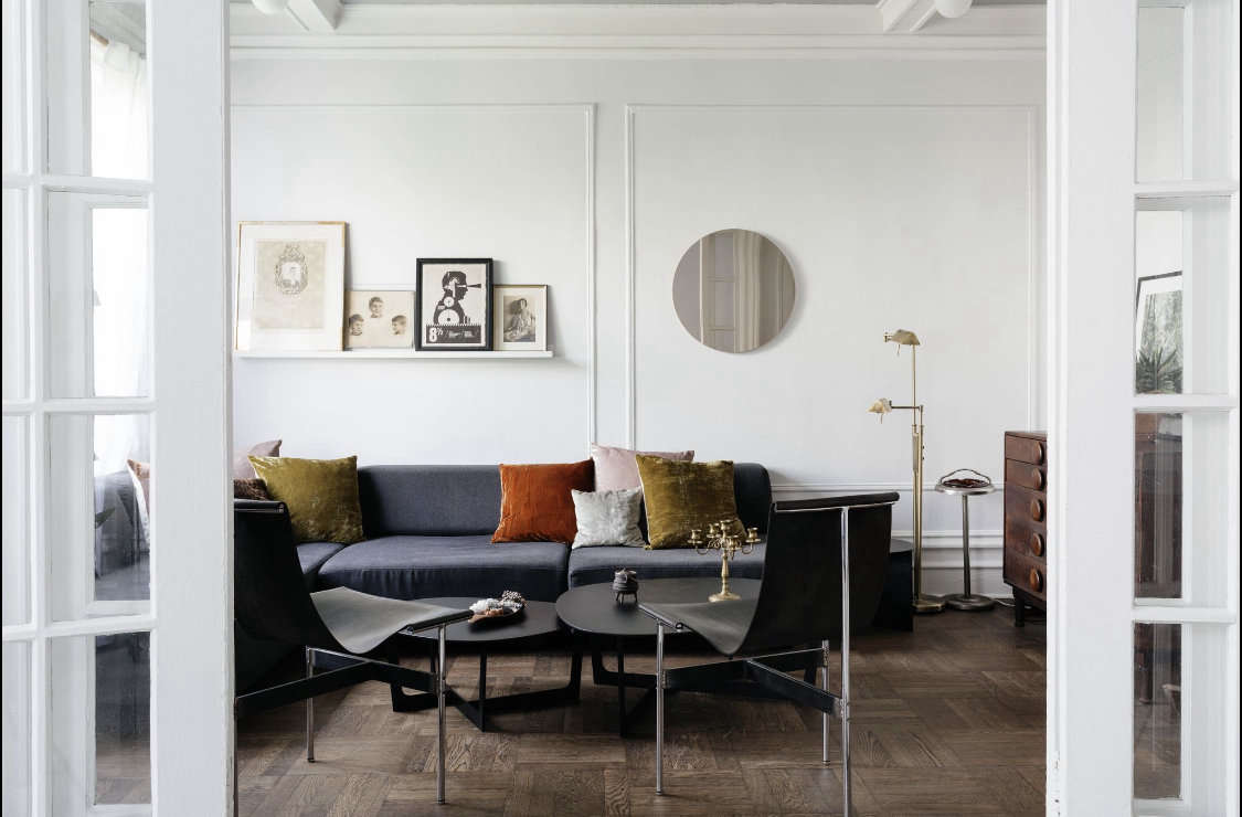 To give the pre-war apartment a more modern feel, Delia had all the walls and millwork painted a super-pale gray. &#8
