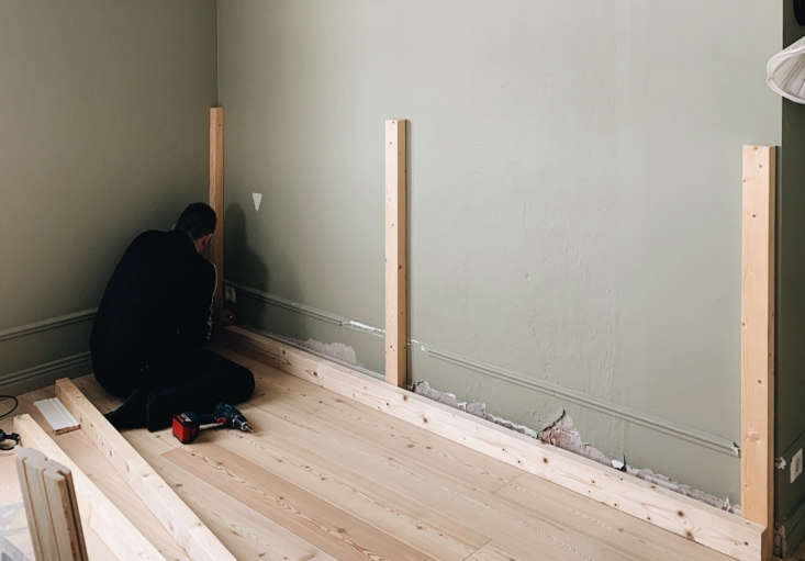 Janne installs the frame.