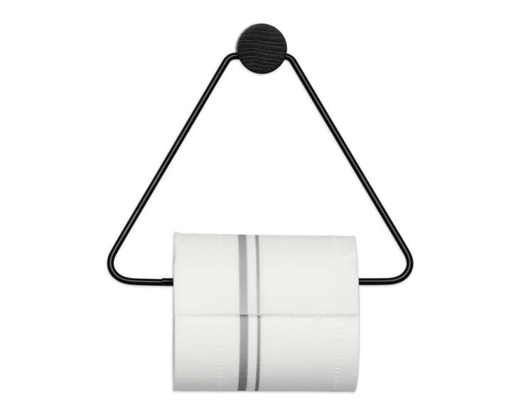 The Ferm Living Black Toilet Paper Holder of powder-coated metal and black-stained oak is $35 from Burke Decor.