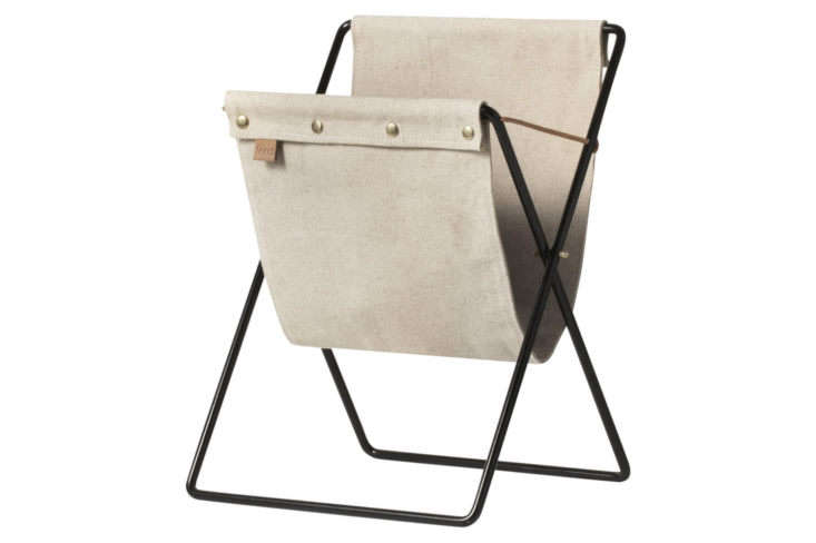 A good combo gift: the canvas and metal Ferm Living Herman Magazine Rack, $93.84, paired with an interesting magazine or book.