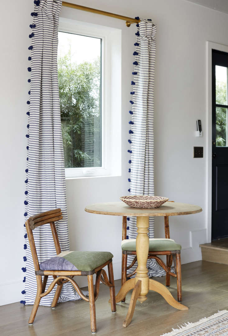 The table for two is set off by Pom Tassel Curtains from Anthropologie.