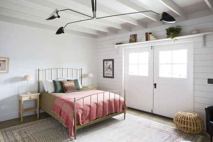 The carriage door wall has horizontal paneling that Shanty says is similar to Home Depot&#8