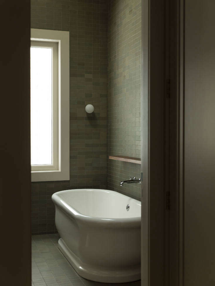 A freestanding tub, the Hanley Bath from The Water Monopoly, is paired with a Perrin & Rowe bath faucet.