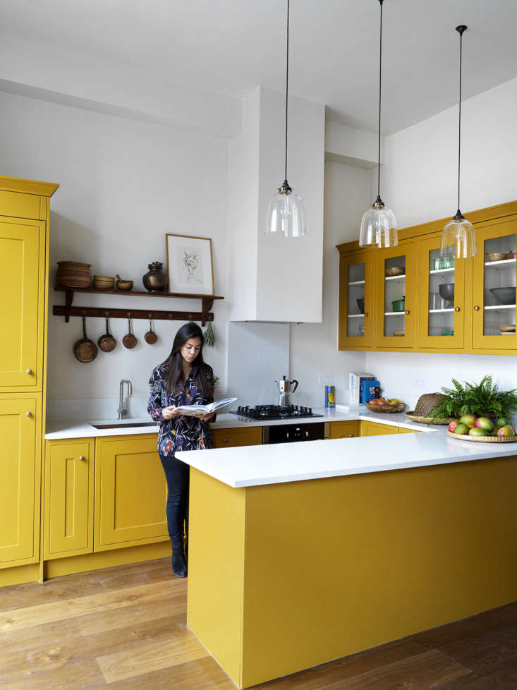 Lonika designed a U-shaped kitchen with Shaker-style cabinets (purchased through her builder) that she managed to convince her mother to paint in Paint & Paper Library&#8