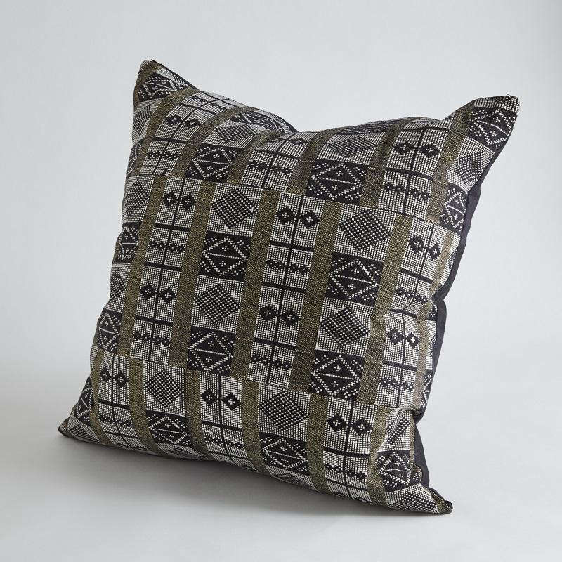 The Bamako Pillow is woven using a strip weave technique.
