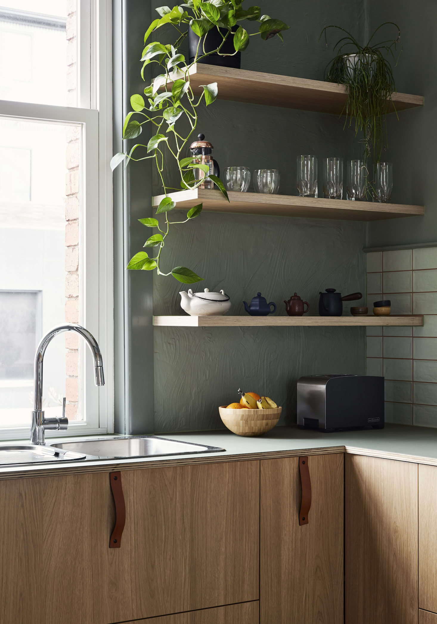 The faucet is from Methven. (For similar faucets, see  Easy Pieces: Modern Single-Lever Gooseneck Kitchen Faucets.) The leather handles are from Melbourne-based company Made to Measure.