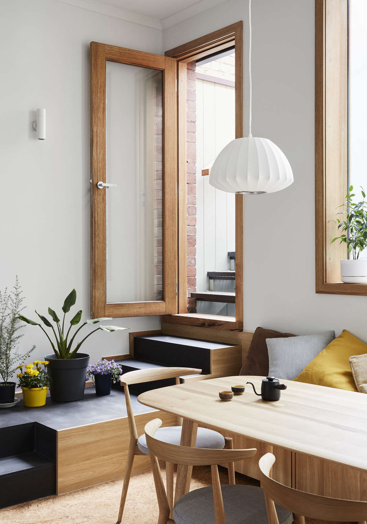The dining table and chairs are from Japanese furniture store Apato, in Victoria.