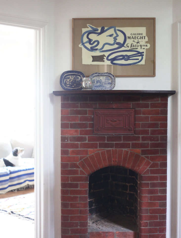 The brick fireplace in the hall was once used to warm guests on arrival.