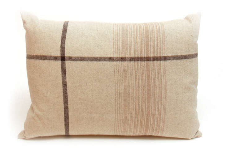 The Asymmetrical Stripe Pillow is made of 40 percent linen and 60 percent cotton, https://www.remodelista.com/products/natural-asymmetrical-stripe-pillow/and comes with a 0 percent down fill insert; regularly priced at $loading=