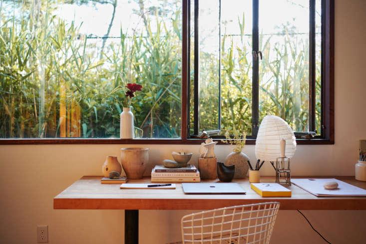 A mix of organic materials—and an open window—make for an inspiring home workspace.