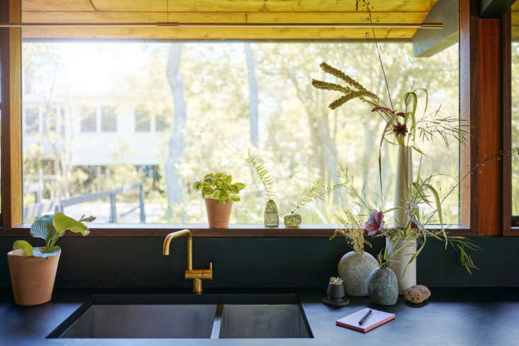 A collection of vases adds height and subtle greenery. We like the petite Little Gem Vases ($), made in Portland, OR, on the windowsill. To the left of the sink is the Studio Planter in Whitewash (from $), designed by Bloomist and made from local terracotta clay by Honduran artisans.