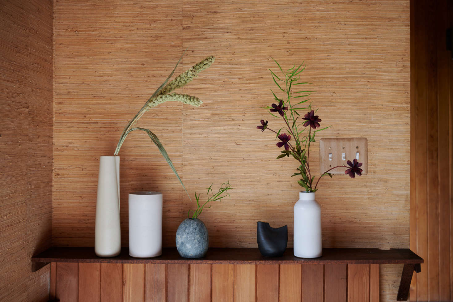 Bloomist offers an array of handmade, organically shaped vases that are every bit as thoughtful as blooms and stems they hold. From left to right: the Off-White Novah Pitcher ($45, pictured with Dried Spray Millet, $); Tracie Hervy's White Stoneware Tall Cylinder Vase ($src=