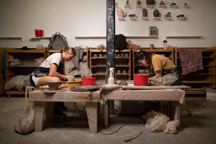 Leta Heigley and Brooke Willis work on bowls for the Pinnacle Collection; the ceramics studio focuses on making tableware.