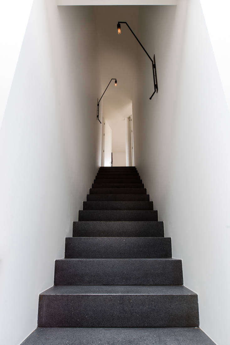 Along the stairwell are two custom Colombe-designed wall lights.