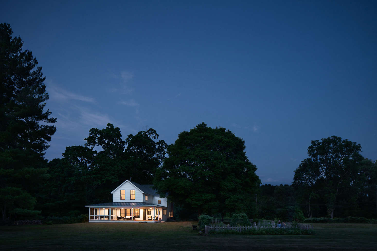 At twilight, the house looks like a Maxfield Parrish painting.