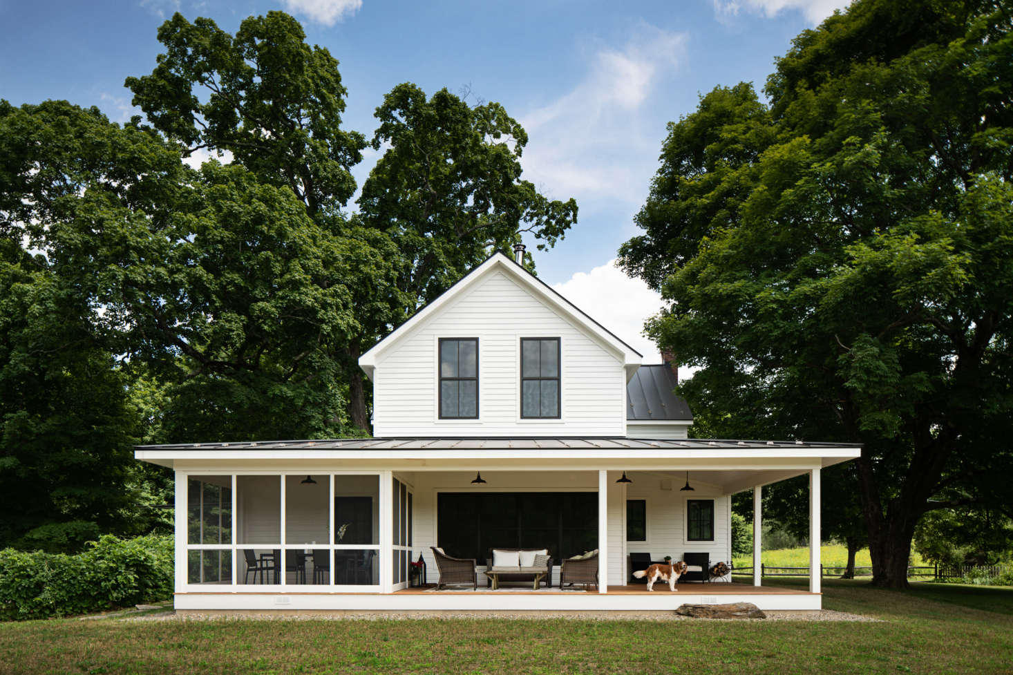 The back porch, both screened and open-air, serves as the family&#8