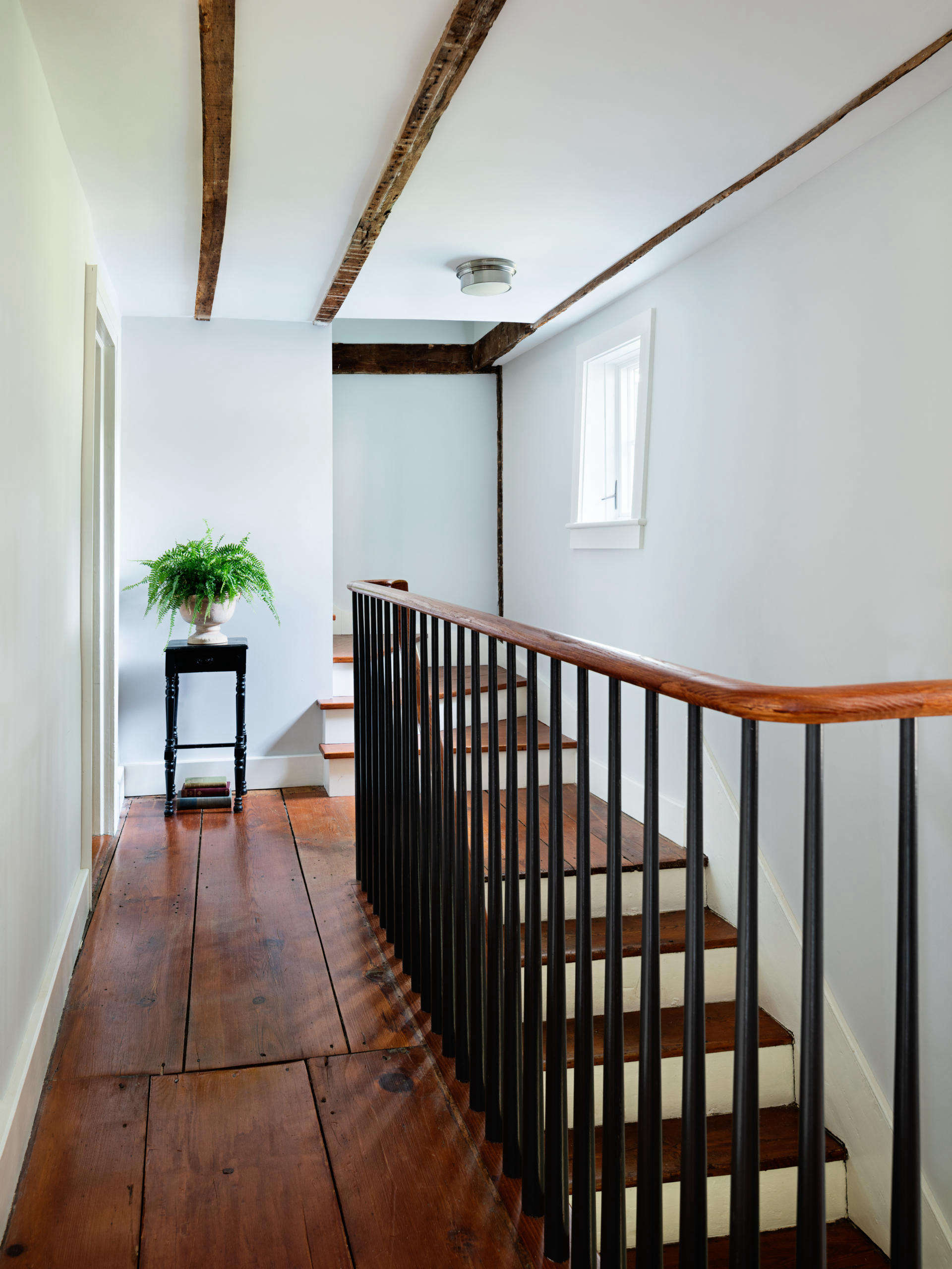The house retains its original stair (with a new railing in place of a Sheetrock wall) and extra-wide floorboards.
