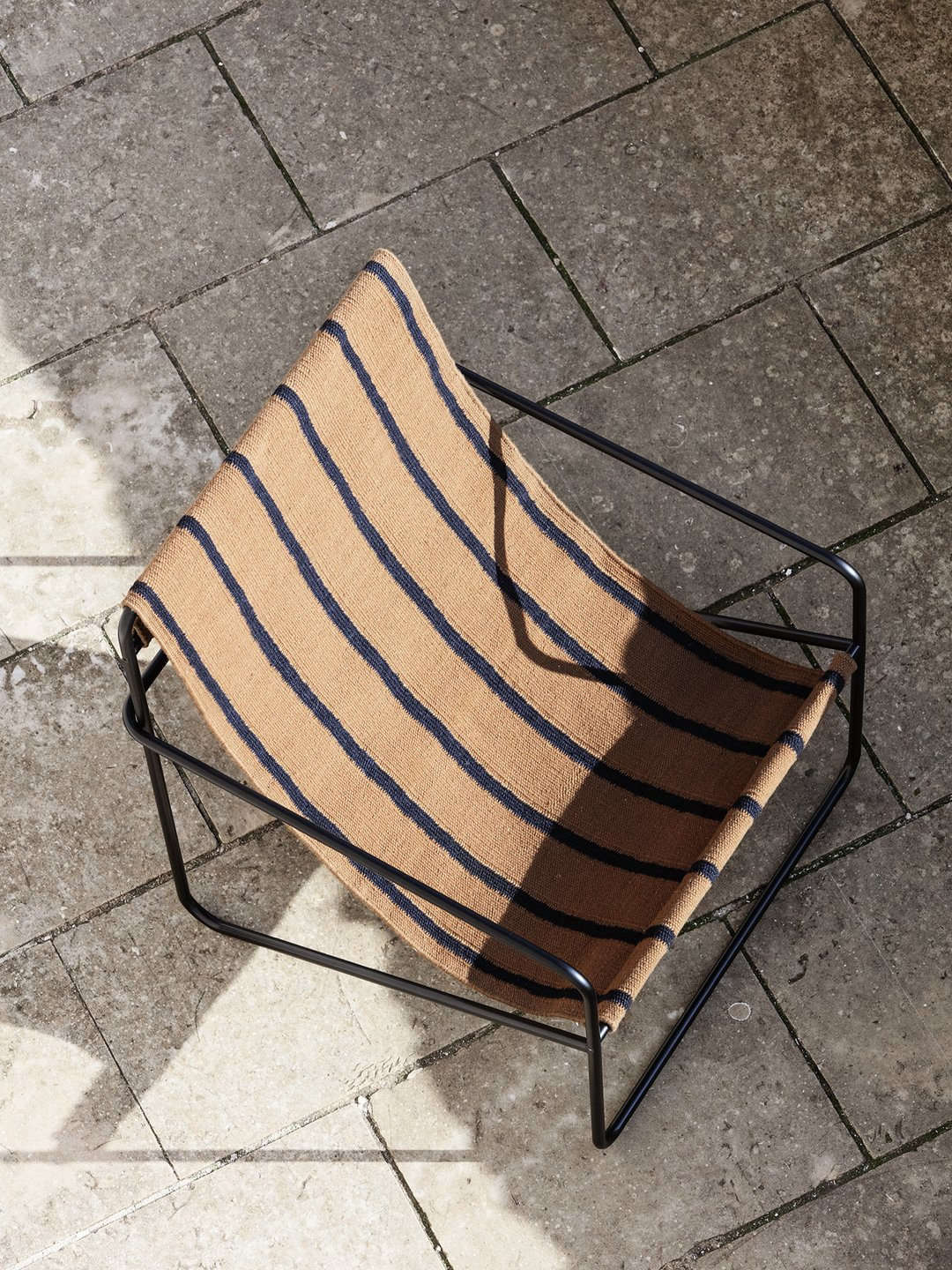 A detail of the Desert Lounge Chair in Black/Stripes; $345 from Lekker Home.