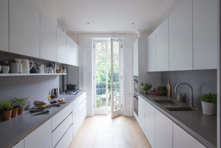 composed of streamlined cabinets of laminate clad mdf with oak edging, the kitc 9