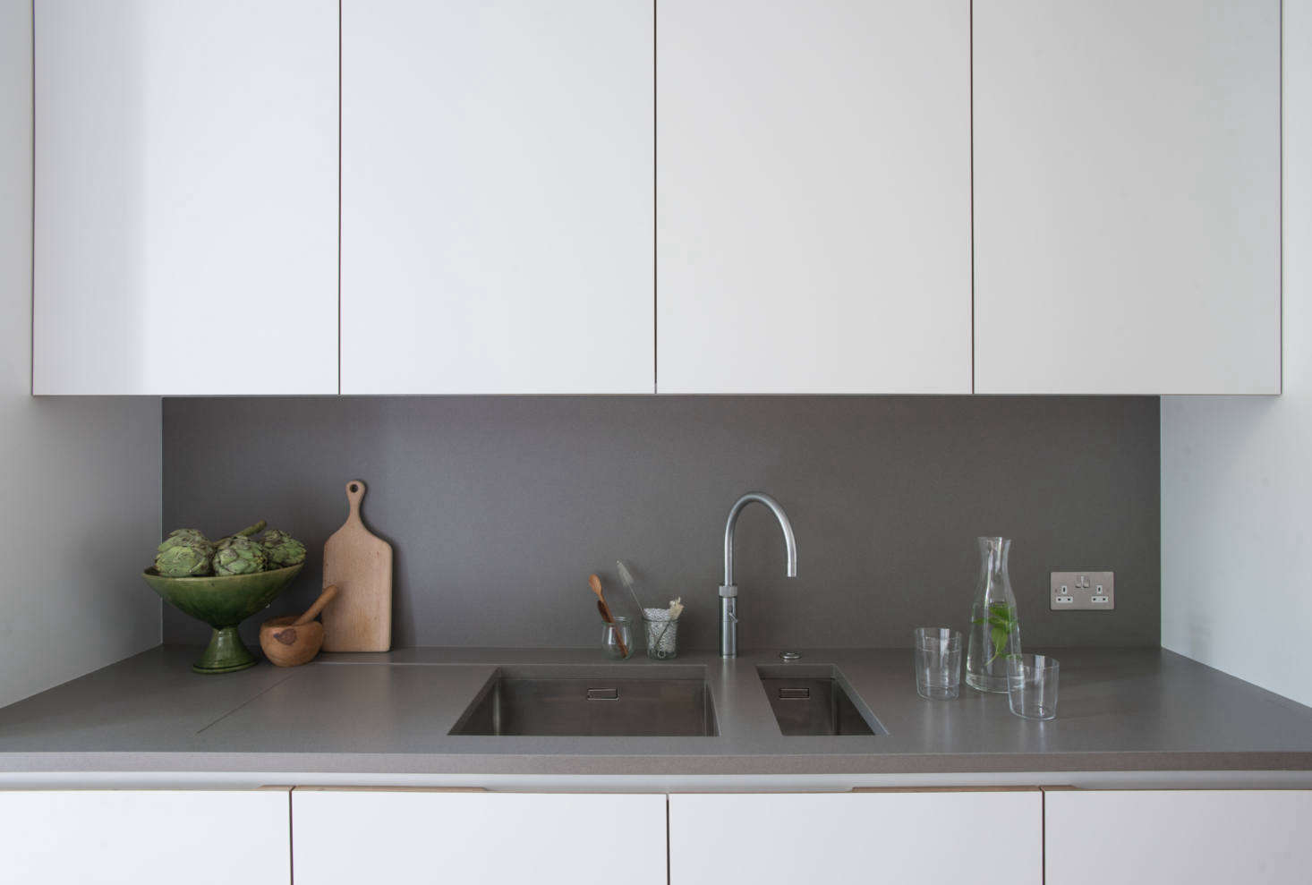 The cabinets are detailed with birch plywood pulls and interiors. Jack notes that the cabinets on this side were designed &#8