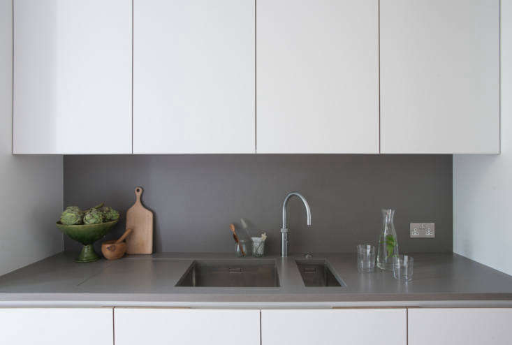 the cabinets are detailed with birch plywood pulls and interiors. jack notes th 14