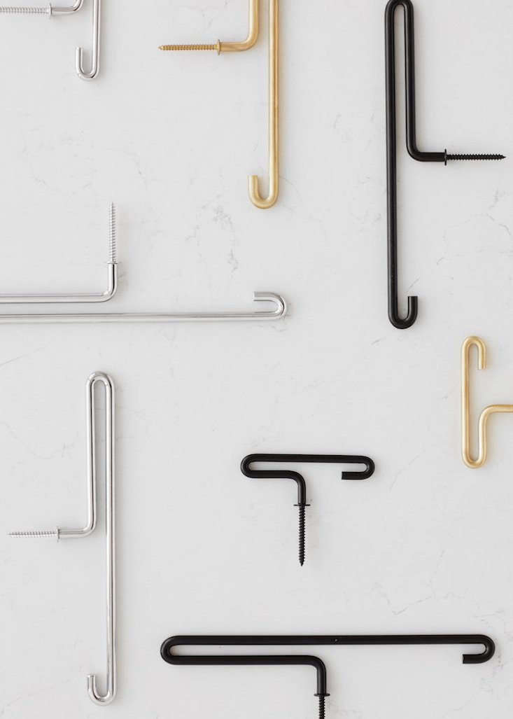 The hook is available in a choice of solid brass, black powder-coated steel, or chrome coated steel.