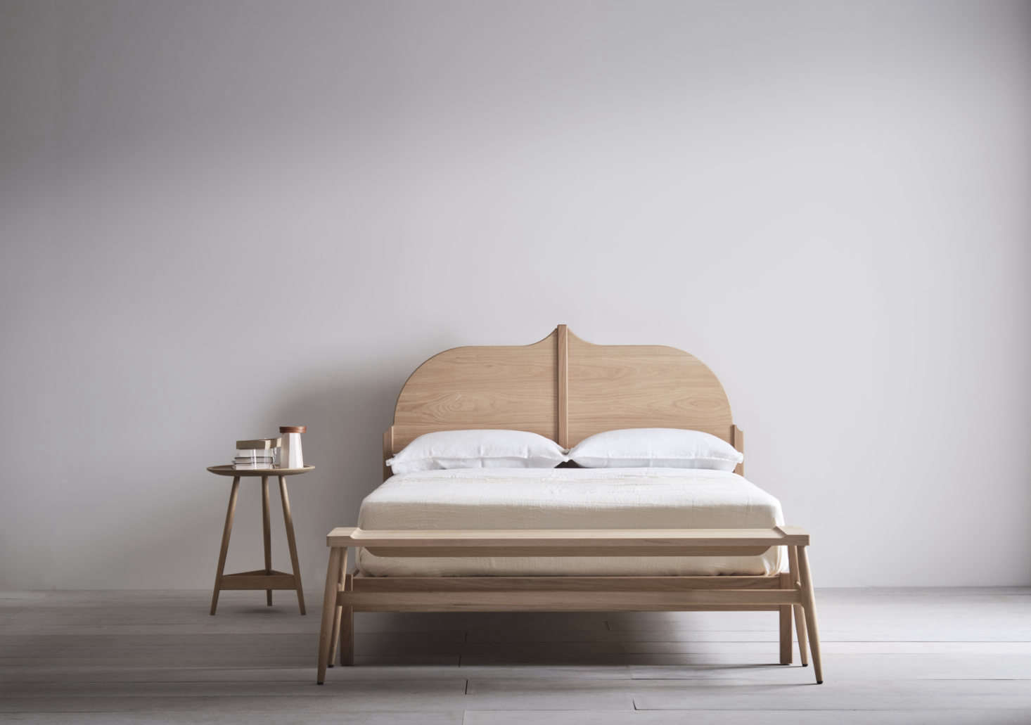 In addition to American black walnut, the frames are offered in European oak with a white oil finish. This Christo Bed is UK king size (which is the equivalent of an American queen.)
